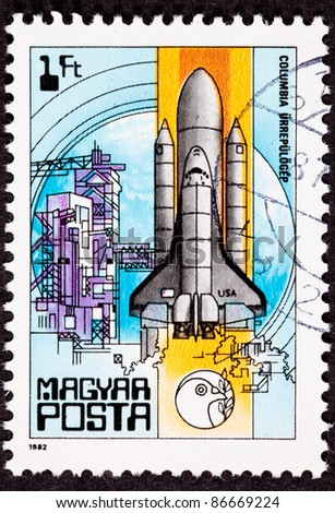 HUNGARY - CIRCA 1986:  A stamp printed in Hungary shows the Space Shuttle Columbia lifting off from its launch tower, in Cape Canaveral in Florida, USA, circa 1986. - stock photo