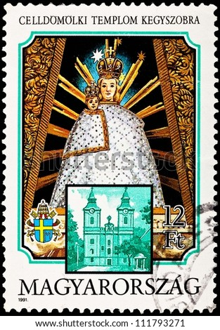HUNGARY - CIRCA 1991:  A stamp printed in Hungary shows the Virgin Mary and Christ artwork from Celldomolk Cathedral in Hungary, circa 1991. - stock photo