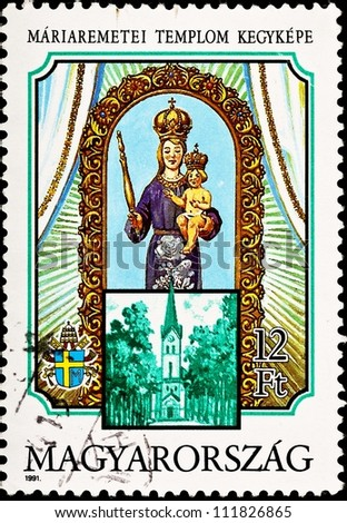 HUNGARY - CIRCA 1991:  A stamp printed in Hungary shows the Virgin Mary and Christ from Mariaremete, the Basilica of the  Virgin Mary in Budapest, Hungary , circa 1991.