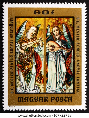 HUNGARY - CIRCA 1973: a stamp printed in the Hungary shows Angels Playing Violin and Lute, Painting by Hungarian Anonymous Early Master, from the Christian Museum at Esztergom, circa 1973