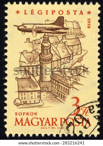 HUNGARY - CIRCA 1958: A stamp printed in the Hungary shows Plane over Sopron, Anniversary of Hungarian Air Post Stamps, circa 1958 - stock photo