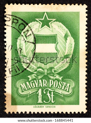 HUNGARY - CIRCA 1957: Green color stamp printed in Hungary with image of a Hungarian star emblem, circa 1957.