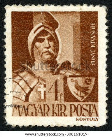 HUNGARY - CIRCA 1943: post stamp printed in Hungary (Magyar) shows Janos Hunyadi in armor; portraits; leader of military, political figure; Scott 604 A99 4f brown, circa 1943