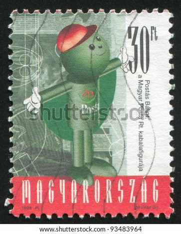 HUNGARY - CIRCA 1998: stamp printed by Hungary, shows Balint Postas (Post Office Mascot) Staying Straight with Arms Outstretched in Front of the Printed Material, circa 1998