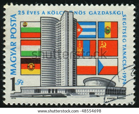 HUNGARY - CIRCA 1974: stamp printed by Hungary, shows Comecon Building Moscow and Flags, circa 1974.