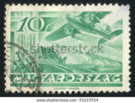 HUNGARY - CIRCA 1936: stamp printed by Hungary, shows Fokker F VII over Mail Coach, circa 1936