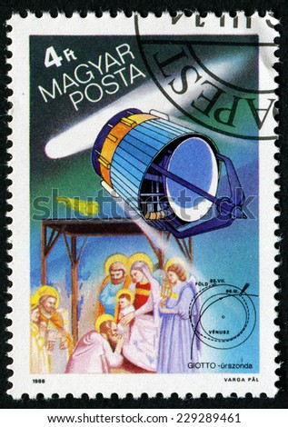 HUNGARY - CIRCA 1986: stamp printed by Hungary, shows Halley's Comet, European Space Agency Giotto, The Three Magi, tapestry by Giotto, circa 1986 - stock photo