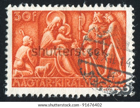 HUNGARY - CIRCA 1943: stamp printed by Hungary, shows relief Adoration of the Magi, circa 1943 - stock photo