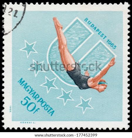 HUNGARY - CIRCA 1965: stamp printed by Hungary, shows Woman diver, circa 1965  - stock photo