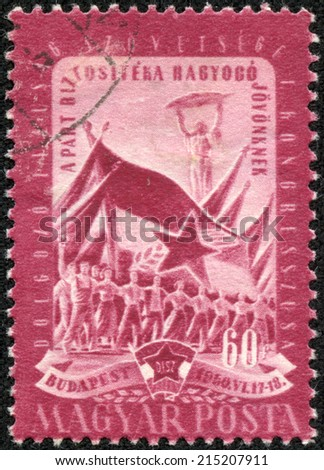 HUNGARY - CIRCA 1950: stamp printed by Hungary, shows worker, peasant and student and flags, circa 1950 - stock photo