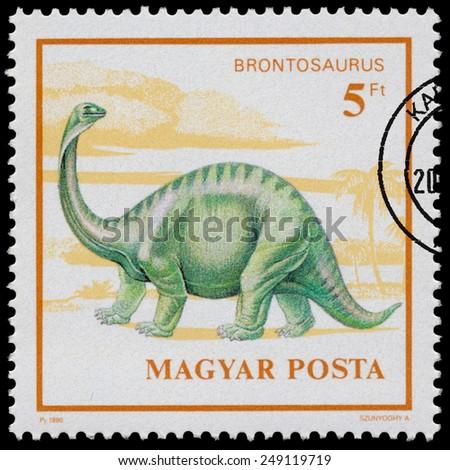 "HUNGARY - CIRCA 1990: Stamp printed in Hungary from the ""Prehistoric Animals "" issue shows Brontosaurus, circa 1990. - stock photo"