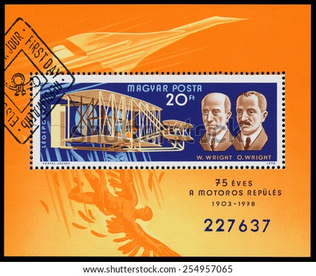 HUNGARY - CIRCA 1978: Stamp printed in Hungary shows The Wright brothers were building the world's first successful airplane and making the first human flight, circa 1978. - stock photo
