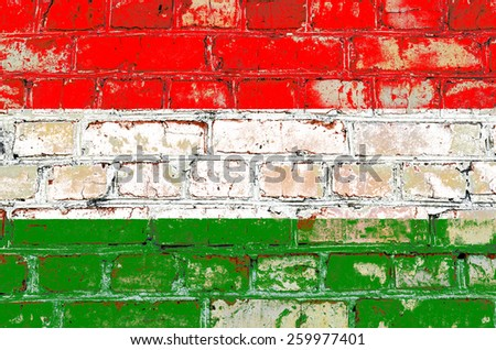 Hungary flag painted on old brick wall texture background - stock photo