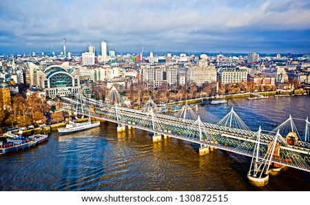 Hungerford Bridge over the River Thames in London - stock photo