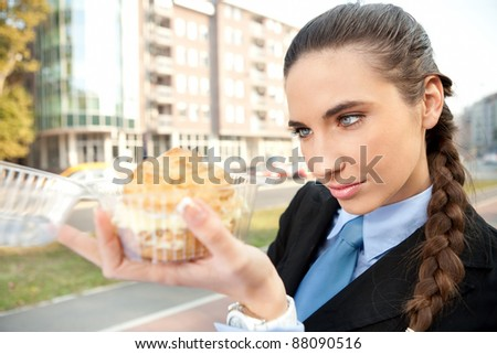 hungry  businesswoman looking in  donut princess, outdoor - stock photo
