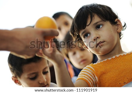 Hungry children in refugee camp - stock photo