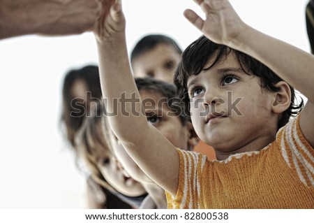 Hungry children in refugee camp, distribution of humanitarian food - stock photo