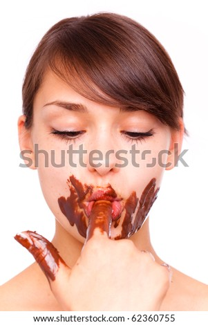Hungry chocolate eating licking female full of chocolate