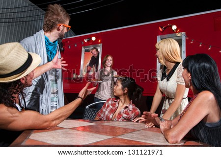 Hungry group of friends getting pizza at red food truck - stock photo
