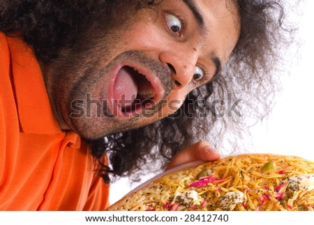 Hungry man eating a tasty pizza . - stock photo