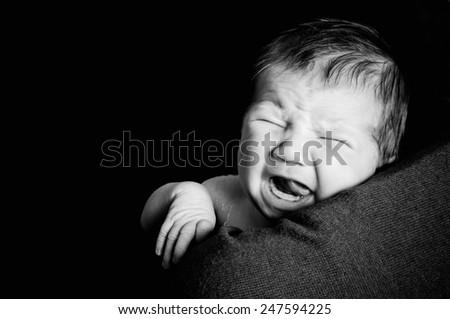 Hungry newborn baby - stock photo
