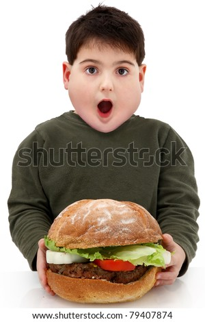 Hungry obese fat boy child with giant hamburger over white. - stock photo