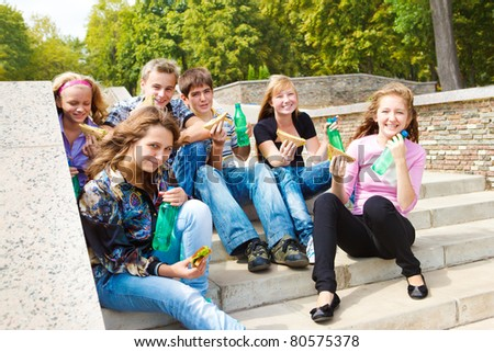 Hungry teenagers having snack time - stock photo