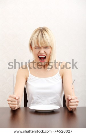 Hungry woman screaming. - stock photo