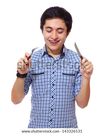 hungry young man with a knife and a fork
