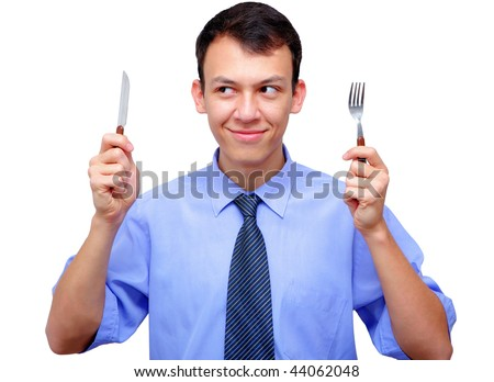 hungry young man with a knife and a fork - stock photo