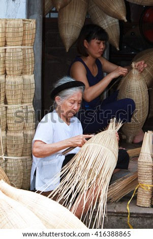 HUNGYEN, VIETNAM - JUNE 21 2015 :Unidentified woman was weaving bamboo in HungYen, Vietnam. Weaving this tools that used to catch fish is traditional occupation in Hung Yen province.