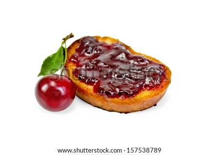 Hunk of toasted bread with cherry jam isolated on white background