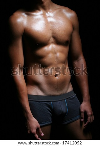 hunky asian young male in boxer trunks - stock photo