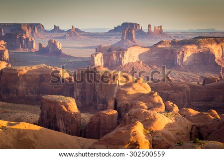 Hunt's Mesa, Arizona, Monument Valley Navajo Tribal Park, canyons and mittens at sunrise - stock photo