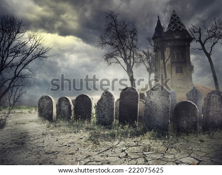 Hunted house on spooky graveyard - stock photo