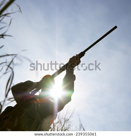 Hunter Aiming Shotgun - stock photo