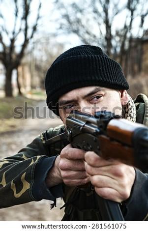 Hunter aiming to kill the dangerous animal - stock photo