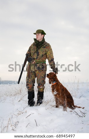 Hunter and his hunting dog waiting for the hunt to begin. General winter open season image