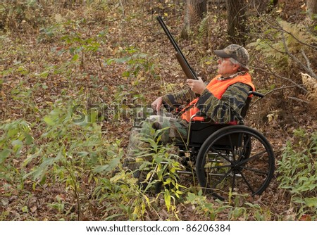 hunter in a wheelchair in the Autumn woods