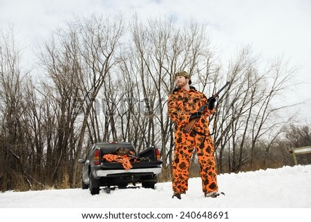 Hunter in Orange Camouflage - stock photo
