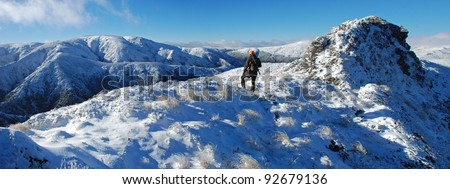 hunter in snowy mountains - stock photo