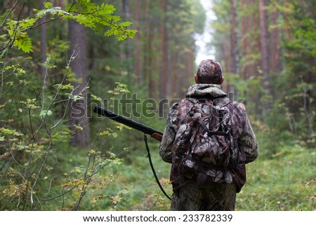 hunter in the forest - stock photo