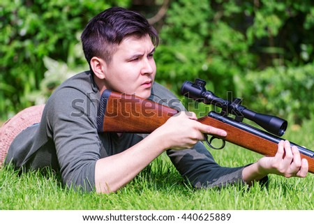 Hunter in the wilderness looking for his target - stock photo