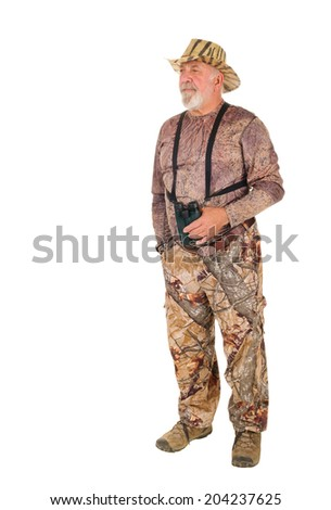 Hunter looking to the side for game with binoculars, isolated on white with room for your text - stock photo