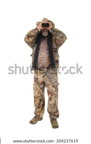 Hunter looking towards viewer with binoculars, isolated on white - stock photo