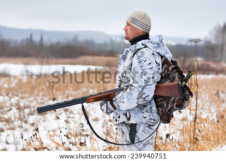 hunter on the snowy field
