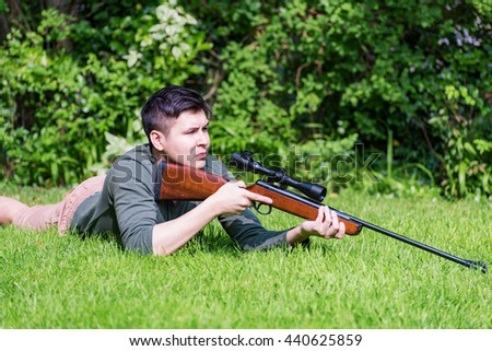 Hunter outdoor looking for prey - stock photo