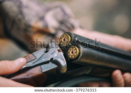 hunter rifle cartridges - stock photo
