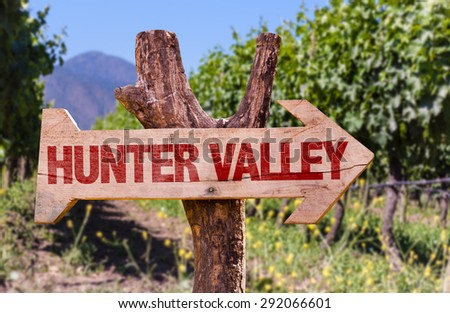 Hunter Valley wooden sign with winery background - stock photo