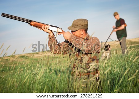 Hunter wild duck hunting - stock photo